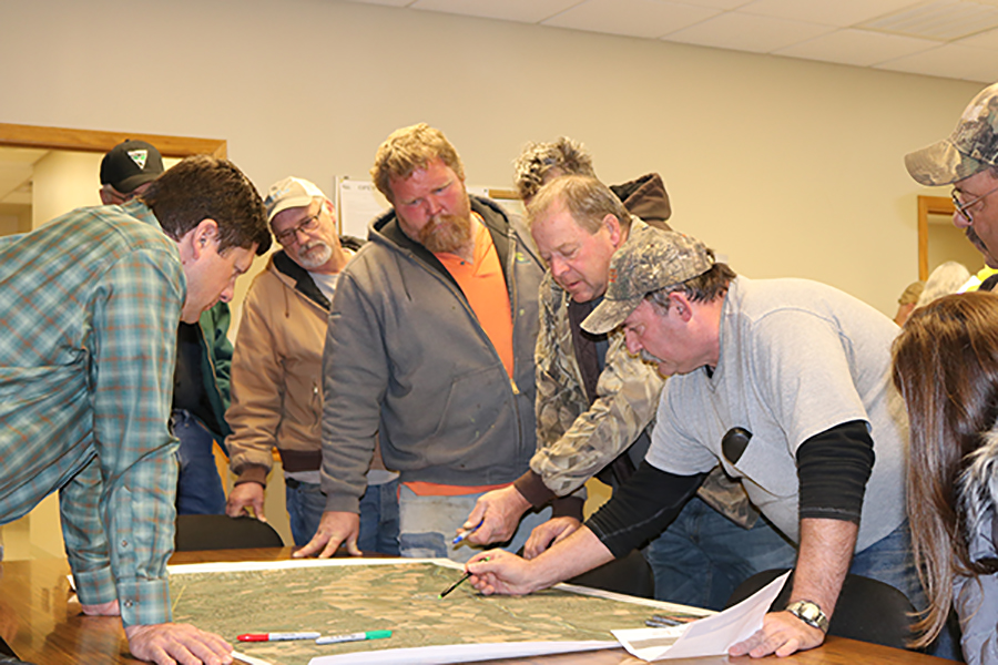 Sargent residents use maps to indicate areas of flooding concerns.